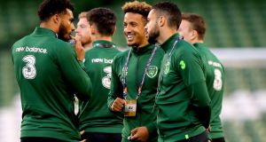 Callum Robinson (centre) talks to Cyrus Christie (left) and Derrick Williams as the Ireland players walk the pitch after arriving at the Aviva stadium ahead of Nations League game against Wales. Photograph: Ryan Byrne/Inpho