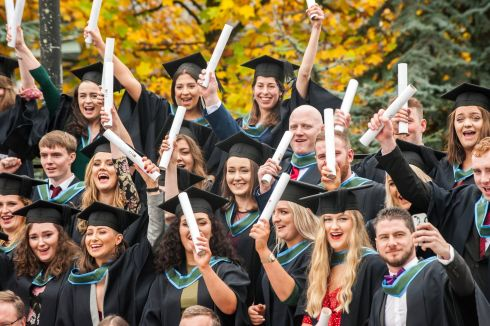 GRADUATION SEASON: More than 3000 students from across all four Colleges will be conferred at UCC over the next fortnight. Graduates celebrate after their group photo in UCC, Cork. Photograph: Daragh Mc Sweeney/Provision