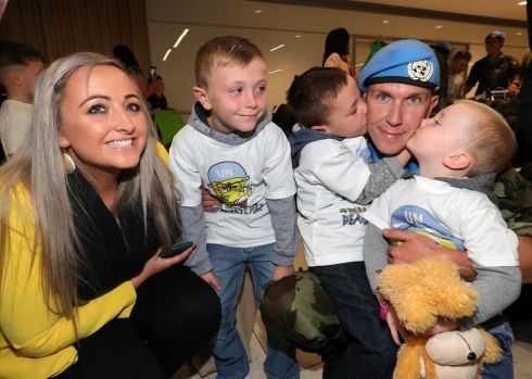 SOLDIER'S RETURN: Cpl. John Paul Harrington from Tipperary is welcomed home by his wife, Sinead and their children, Donacha (3), Lorcan (5) and Rian (7) early on the morning of October 16th at Dublin Airport when 119 Irish troops from the 57th Infantry Group, United Nations Disengagement Observer Force (UNDOF) returned home following a six month deployment to the Golan Heights and Syria. Photograph: Colin Keegan/Collins
