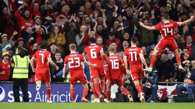 Wales players celebrate Harry Wilson's goal with the travelling support at the Aviva stadium. Photograph: Niall Carson/PA Wire