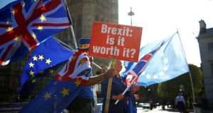 Anti-brexit protestors wave flags outside the Houses of Parliament in London. Photograph: Henry Nicholls/Reuters