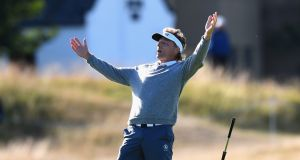 Bernhard Langer celebrates making a birdie on the 17th during the 2018 Senior Open at  St Andrews. Photograph: Tony Marshall/Getty