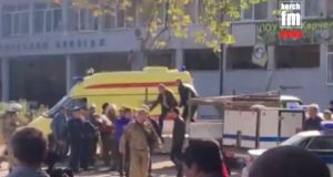 Emergency services carry an injured victim of a blast at at a college in the port city of Kerch, Crimea in this still image taken from a video on Kerch.FM.