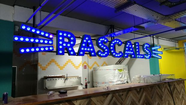 Bright new signage goes up above the pizza bar inside Rascals new Dublin 8 home