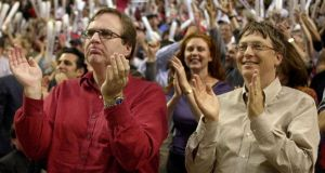 Microsoft co-founder Paul Allen (left), who died this week aged 65, is pictured with Bill Gates cheering his basketball team the Portland Trail Blazers in 2000. Photograph: File photograph: Reuters