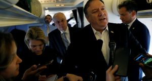 US secretary of state Mike Pompeo speaks to reporters while his plane refuels in Brussels on Wednesday. Photograph: Leah Millis/Reuters