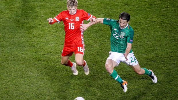 Harry Arter challenges David Brooks of Wales. Photograph: Gary Carr/Inpho
