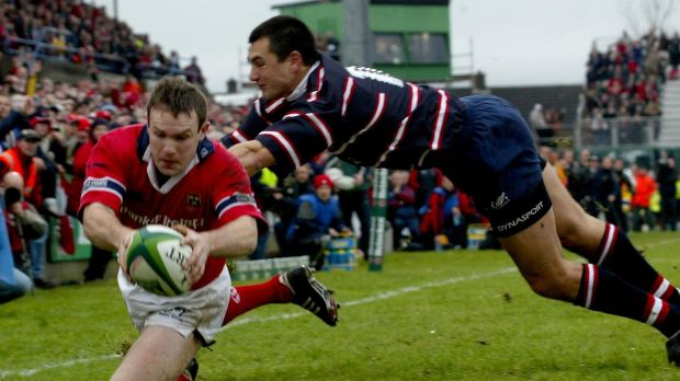 Munster's John Kelly goes over for a try as Gloucester's Thinus Delport closes in during Munster's thrilling victory in the 2003 Heineken Cup. Photograph: Morgan Treacy/Inpho