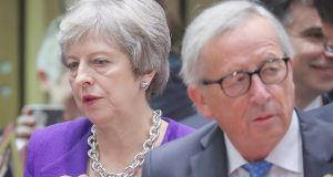 British prime minister Theresa May and European Commission president Jean-Claude Juncker at the start of the European Council summit in Brussels. Photograph: EPA/Olivier Hoslet