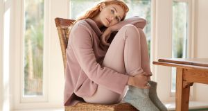 Lounge in style with Carolyn Donnelly's new collection for Dunnes Stores. Pictured here is a fleece sweater (€49), jersey sweatpants (€49) and fleece booties (€25)