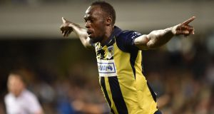 Olympic sprinter Usain Bolt celebrates scoring a goal for A-League football club Central Coast Mariners in his first competitive start for the club against Macarthur South West United. Photo: Peter Parks/Getty Images