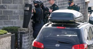 Gardaí  at the scene on St Mark's Drive, Ronanstown. Photograph: Collins