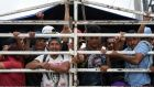Honduran migrants aboard a truck arrive in Guatemala City, while taking part in a caravan towards the US. Photograph: Orlando Sierra/AFP/Getty Images
