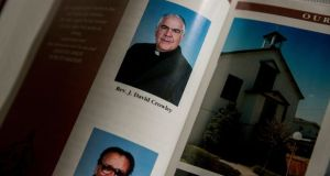 Rev John David Crowley in a church directory at Holy Angels parish. Crowley was named in a grand jury report that listed hundreds of Catholic priests in Pennsylvania accused of abusing children. Photograph: Sam Hodgson/The New York Times