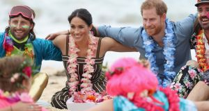 Prince Harry and Meghan take part in a group hug for mental health on  Bondi Beach. Photograph: Chris Jackson/Pool/Reuters