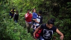 Honduras migrants forced to trek through jungle in hope of reaching US