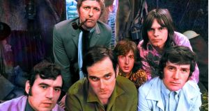 Eric Idle (wee in the dead centre) and the original crew of  Monty Python's Flying Circus
