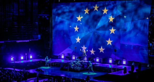 U2 on tour: the band end their European Experience + Innocence shows playing in front of an EU  flag. Photograph: Sergione Infuso/Corbis via Getty