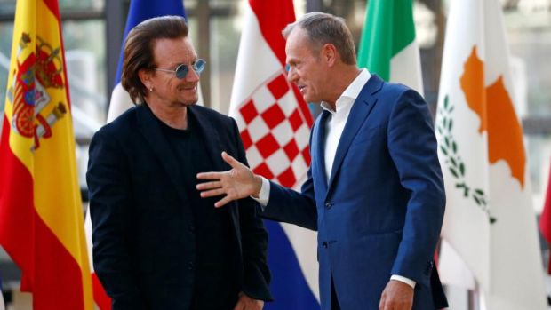 U2 in Europe: Bono with the European Council's president, Donald Tusk, in Brussels. Photograph: François Lenoir/Reuters