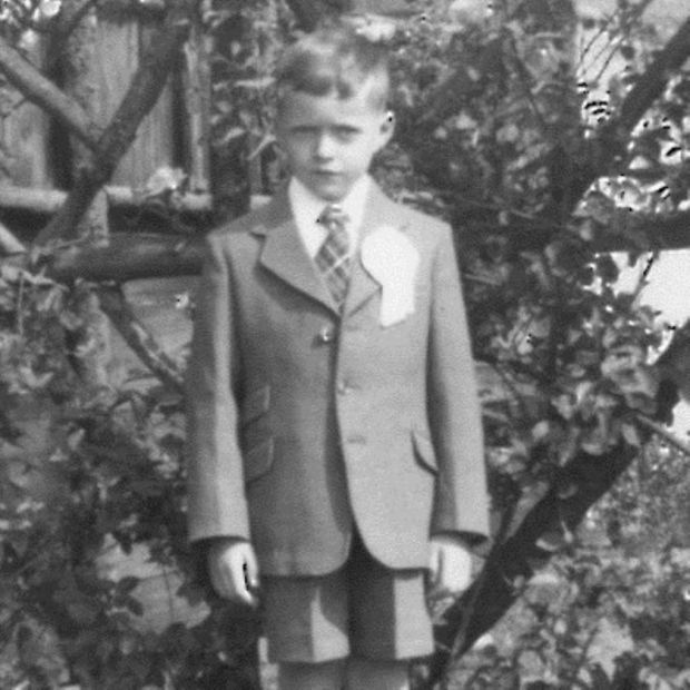 Frank McDonald in his First Communion suit at Glenmore Road in 1957