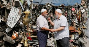Elderly men talk to each other in downtown Amman. Photograph: Muhammad Hamed/Reuters