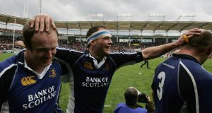 Felipe Contepomi, (centre) celebrates with  Denis Hickie (left) and Will Green after Leinster's  victory over Toulouse in the  Heineken Cup quarter-final at  Stade Municipal  in Toulouse in April 2006. Photograph: David Rogers/Getty Images