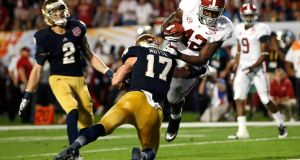 Alabama Crimson Tide and Notre Dame Fighting Irish during  a  college football game. Research suggests former students who attend games are more likely to donate. File photograph: Mike Segar/Reuters