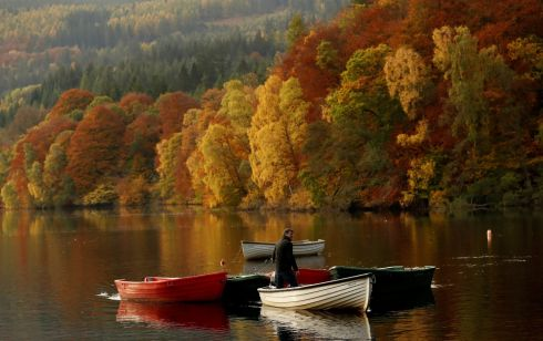 Autumn foliage reflected off Loch Faskally, in Perthshire, Scotland,. Photograph: Russell Cheyne/Reuters