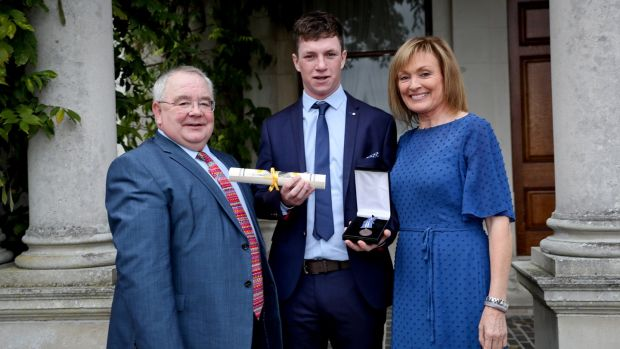 Andrew Johnston with the Ceann Comhairle Seán Ó Fearghaíl and Mary Kennedy after he was awarded a bronze medal for bravery. Photograph: Maxwell's