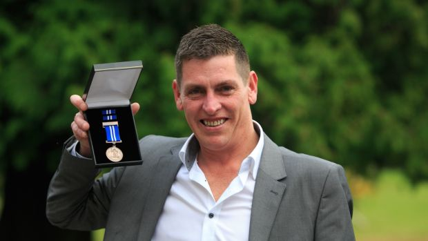 Martin Cullinane with his bronze medal presented for bravery. Photograph: Gareth Chaney Collins