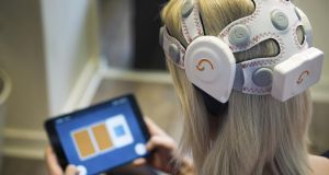 BrainWaveBank headset: the device's sensors collect cognitive data while users play games on a smartphone