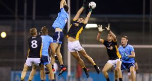 Eamon Donoghue of The Underdogs challenges for the ball with Darren Gavin of Dublin during a challenge match at Parnell Park. Photograph:  Tommy Dickson/Inpho