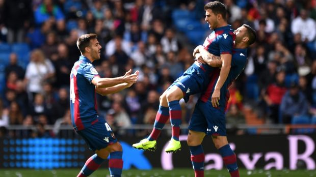 Jose Luis Morales of Levante celebrates with team-mates after scoring his side's first goal during the La Liga match against Real Madrid at Estadio Santiago Bernabeu. Photograph: Denis Doyle/Getty Images