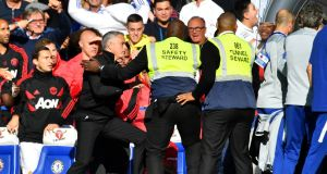 Manchester United manager Jose Mourinho is restrained by stewards after reacting to the celebrations from Chelsea's second assistant coach Marco Ianni after Ross Barkley's late equaliser at Stamford Bridge. Photograph: Dylan Martinez/Reuters