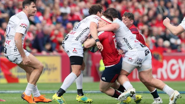 Danny Cipriani (second left) tackles Munster's Rory Scannell and gets a red card. Photo: Brian Lawless/PA Wire