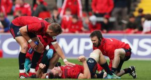 Munster's Tommy O'Donnell lies injured during the Heineken European Champions Cup clash with Gloucester at Thomond Park. Photo: Brian Lawless/PA Wire