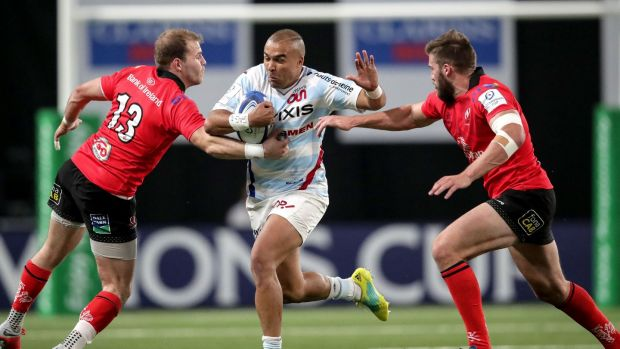 Racing 92's Simon Zebo tries to break through Will Addison and Stuart McCloskey of Ulster during the Heineken Champions Cup match at Paris La Defense Arena. Photograph: James Crombie/Inpho