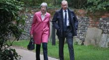 UK prime minister Theresa May and her husband Philip arrive for a church service near to her Maidenhead constituency on Sunday. Photograph: Andrew Matthews/PA Wire.