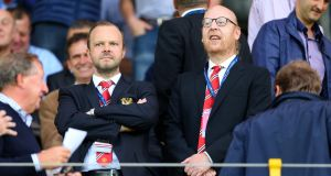 Ed Woodward, chief executive of Manchester United stands with owner Avram Glazer. Photo: Catherine Ivill - AMA/Getty Images
