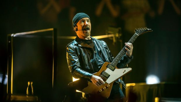 Experience + Innocence: the Edge at U2's Tulsa show. Photograph: Shane Bevel/New York Times