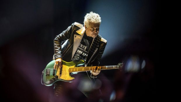 Experience + Innocence: Adam Clayton at U2's Tulsa show. Photograph: Shane Bevel/New York Times