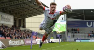 Chris Ashton of Sale Sharks dives in to score his third try of the match during the Challenge Cup match victory over Connacht at AJ Bell Stadium. Photograph: Tony Marshall/Getty