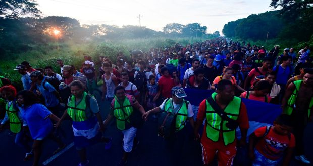 Migrants cross river into Mexico in attempt to reach US