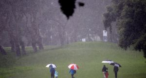 Fans leave the course after the Andalucia Masters was suspended on Sunday. Photograph: EPA