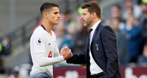 Tottenham's Erik Lamela shakes hands with manager Mauricio Pochettino after being substituted in Spurs' narrow victory over West Ham. Photograph:  David Klein/Reuters