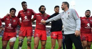 Ugo Mola, joint head coach of Toulouse, congratulates Yoann Huget and his fellow players after the victory over Leinster at Stade Ernest-Wallon in Toulouse. Photograph: Dan Mullan/Getty Images