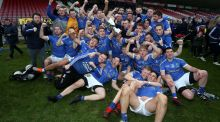 Coalisland players celebrate with the O'Neill Cup. Photograph: Lorcan Doherty/Inpho