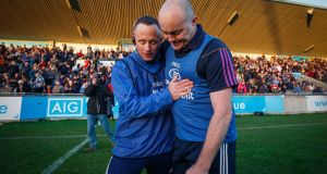 Ballyboden St Enda's manager Joe Fortune embraces Anthony Daly of Kilmacud Crokes after the final whistle. Photograph: Oisin Keniry/Inpho