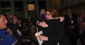 Former Australian prime minister Julia Gillard receives a kiss from an abuse victim during the National Apology to victims and survivors of Institutional Child Sexual Abuse at Parliament House. Photograph: EPA