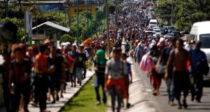 Central American migrants walk along the highway near the border with Guatemala, as they continue their journey trying to reach the U.S., in Tapachula, Mexico. Photograph:  Ueslei Marcelino/Reuters